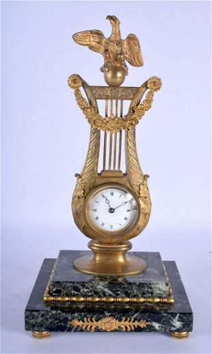 A MID 19TH CENTURY FRENCH EMPIRE STYLE BRONZE AND