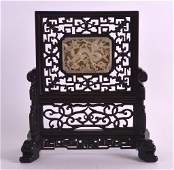 A CHINESE QING DYNASTY CARVED HARDWOOD AND JADE TABLE