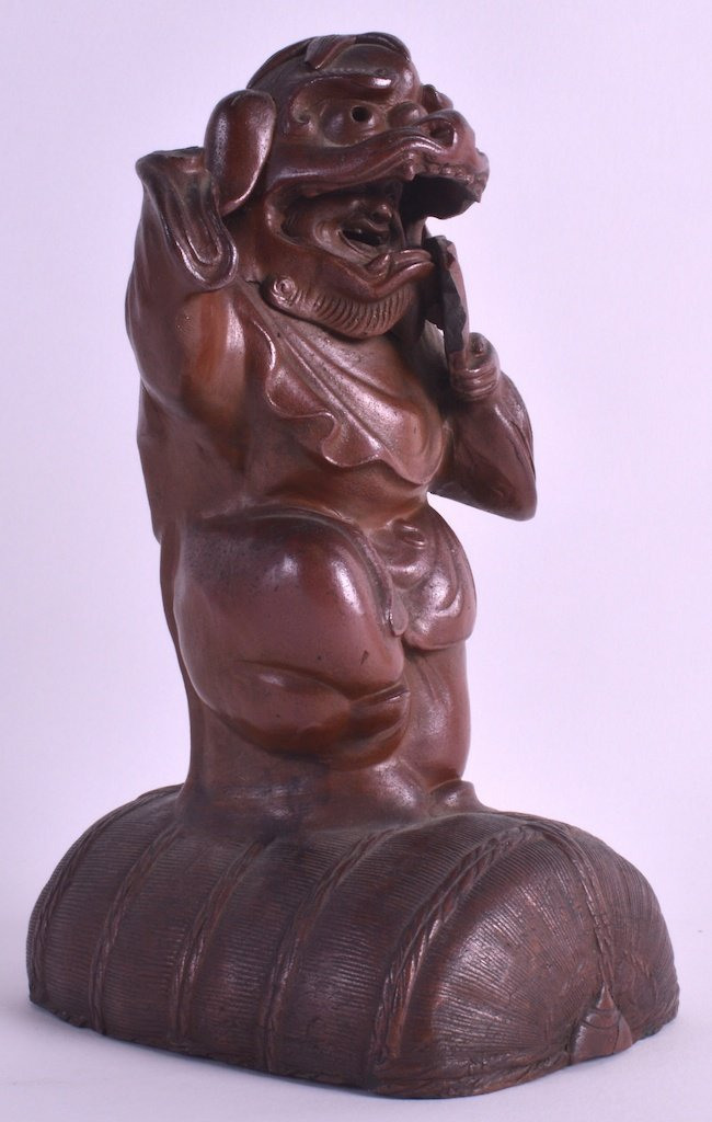 A 19TH CENTURY CHINESE YIXING TYPE POTTERY FIGURE OF A