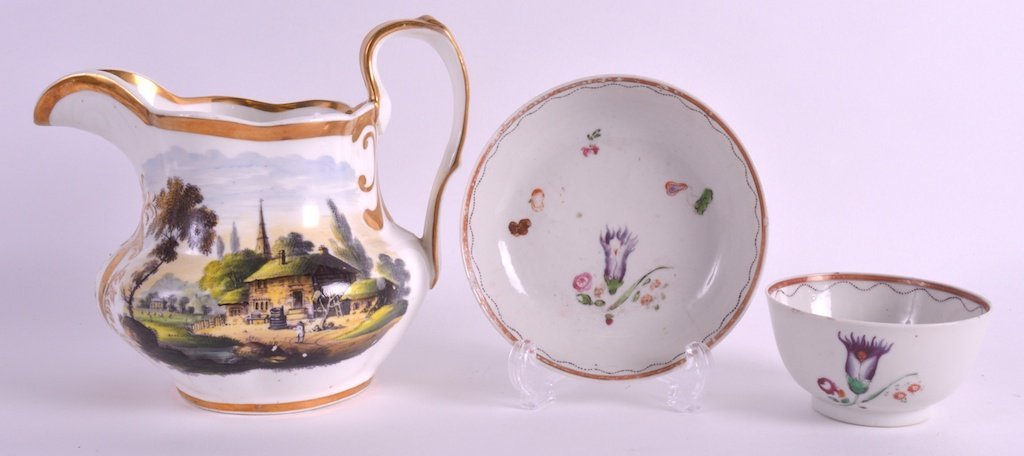 A MID 19TH CENTURY ENGLISH PORCELAIN JUG painted with