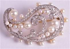 A LOVELY TWO TONE GOLD DIAMOND AND NATURAL PEARL BROOCH