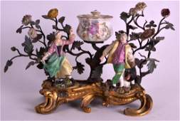 AN 18TH CENTURY PORCELAIN MOUNTED ORMOLU INKWELL