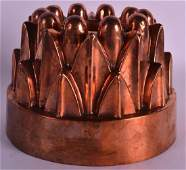 A VICTORIAN COPPER JELLY MOULD. 5.5ins diameter.