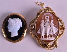 A VICTORIAN CARVED CAMEO BROOCH depicting the three