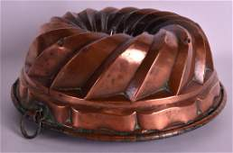 A LARGE VICTORIAN COPPER JELLY MOULD of circular form.