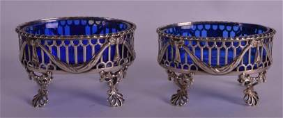 A PAIR OF GEORGE III PIERCED SILVER SALTS with shell