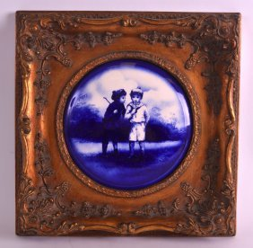 A Framed Victorian Blue And White Panel Depicting Two