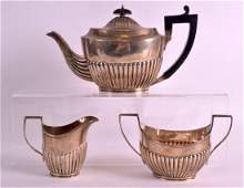 A VICTORIAN THREE PIECE SILVER TEASET with reeded lower