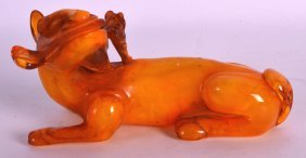 An Early 20th Century Chinese Carved Amber Beast