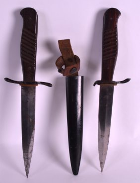 A Near Pair Of German Daggers With Carved Wood Handles,