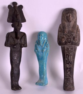 An Early Egyptian Bronze Figure Of God Together With