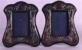 A PAIR OF ART NOUVEAU SILVER PHOTOGRAPH FRAMES with