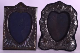 An Edwardian Silver Photograph Frame Together With An