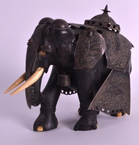 A 19th Century Indian Silver Mounted Ebony Elephant