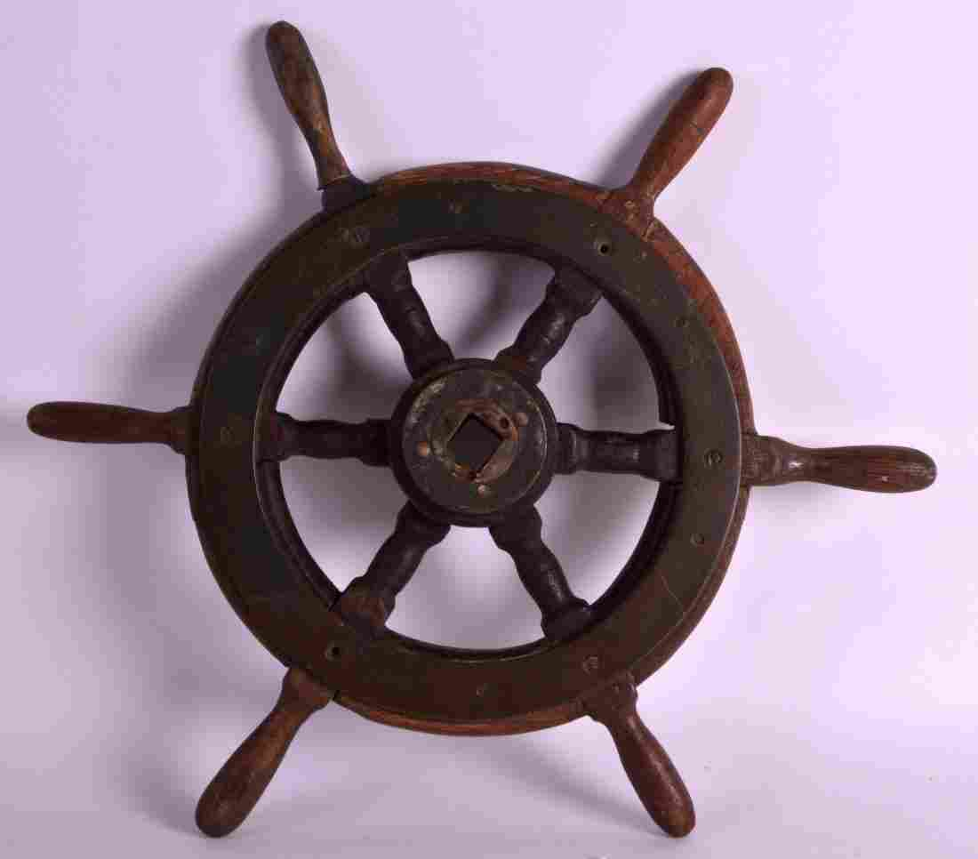 AN EARLY 20TH CENTURY OAK AND BRASS BOUND SHIPS WHEEL.