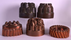 A Collection Of Five Antique Jelly Moulds In Various