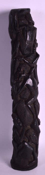 An Early 20th Century Carved African Hardwood Group.