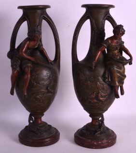 A Pair Of Art Nouveau Spelter Vases With Twin Handles,