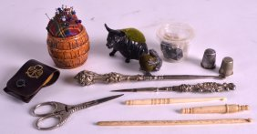 A Group Of Various Sewing Utensils Including A Silver