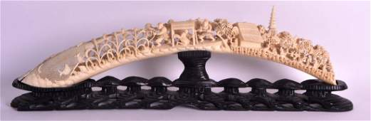 A LARGE LATE 19TH CENTURY CHINESE CARVED IVORY TUSK