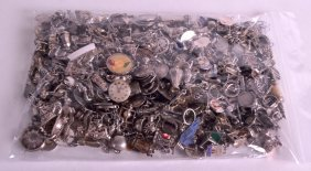 A Large Collection Of Vintage Silver Charms Of Various