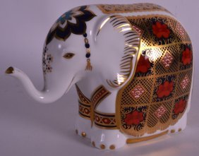 A Boxed Royal Crown Derby Paperweight 'elephant'.