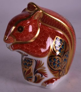 A Boxed Royal Crown Derby Paperweight 'squirrel'.