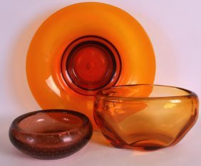 A Heavy Orange Ground Oval Bowl Together With A Similar