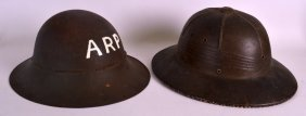A 1940s Pith Helmet Together With Another Similar Tin