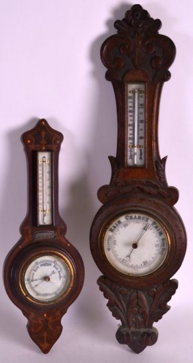 A 1920s Carved Oak Barometer Together With Another