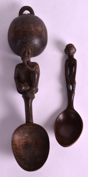 A Mid 20th Century Carved Wood Tribal Spoon Together