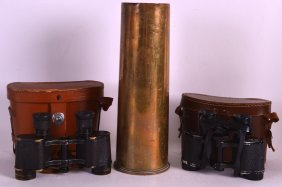 A Wwii Shell Case Together With Two Pairs Of Vintage