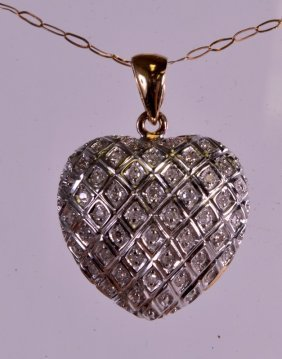 A 9ct Gold And Diamond Heart Necklace.