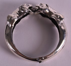 A Heavy Solid Silver Ladies Panther Bangle.