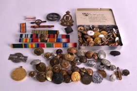 A Collection Of Military Cap Badges Together With