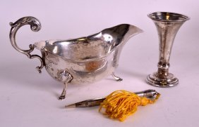 An Edwardian Silver Sauceboat Together With A Silver