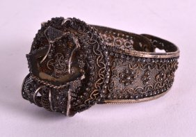 A Late 19th Century Pierced Silver Filigree Bangle.