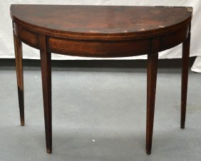 A George Iii Card Table With Folding Top Upon Slender