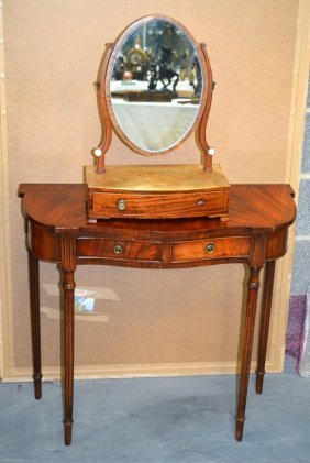A Dressing Table Mirror Together With An Oval Mirror.