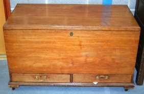 A George Iii Carved Mahogany Trunk With Rising Top And