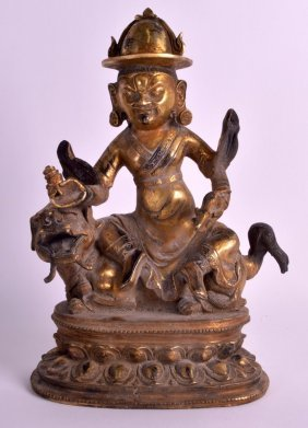 A Chinese Gilt Bronze Figure Of A Guardian Modelled