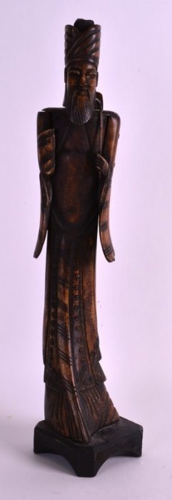 A Chinese Qing Dynasty Carved Bone Figure Of An