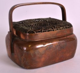 A 19th Century Chinese Copper Hand Warmer And Cover