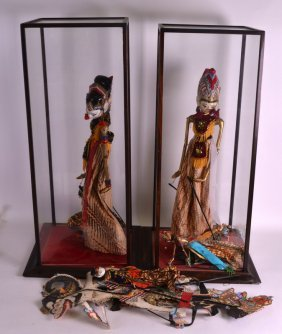 A Large Glass Cased Pair Of South East Asian Figures