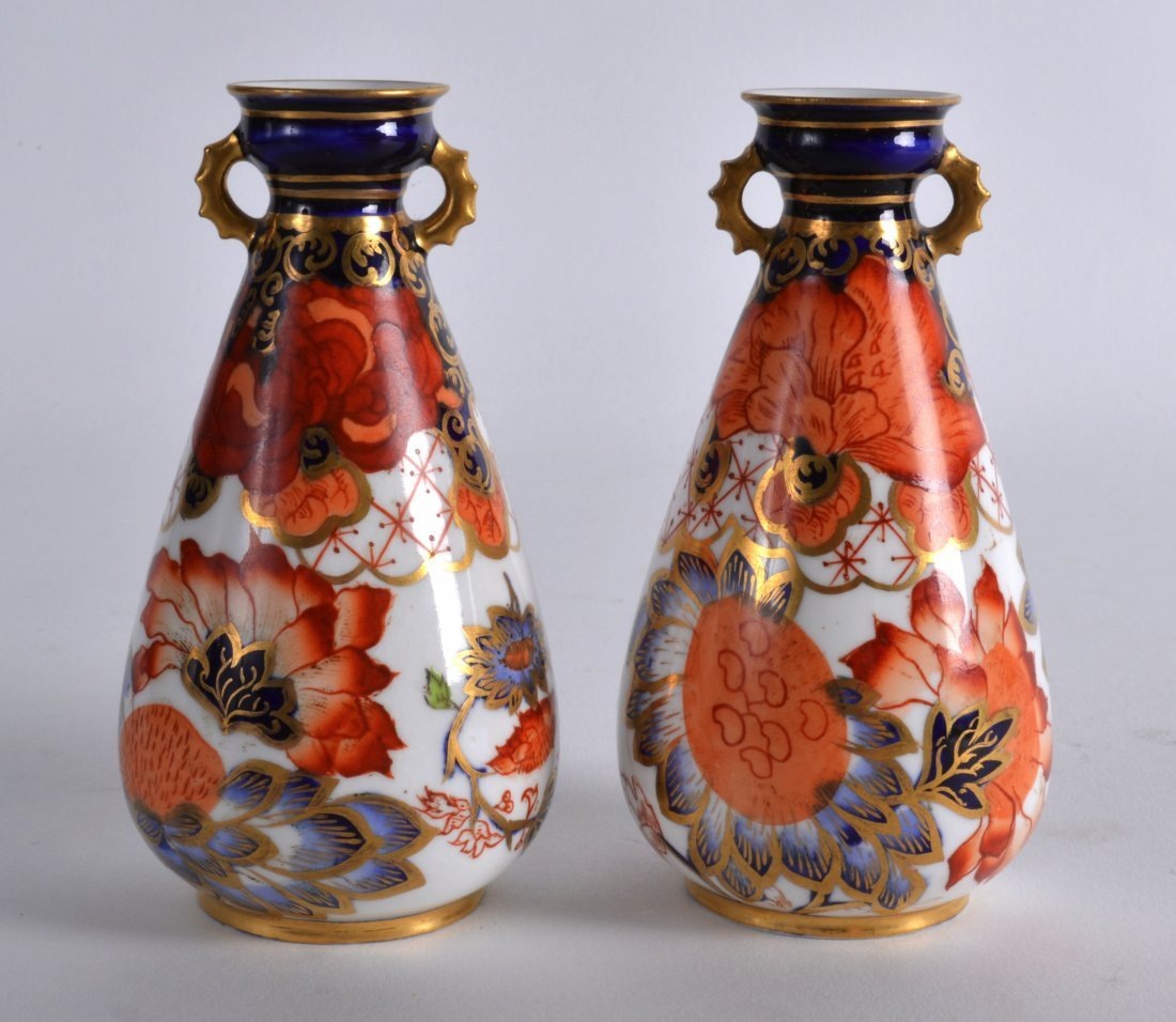 A PAIR OF ROYAL CROWN DERBY TWIN HANDLED VASES painted