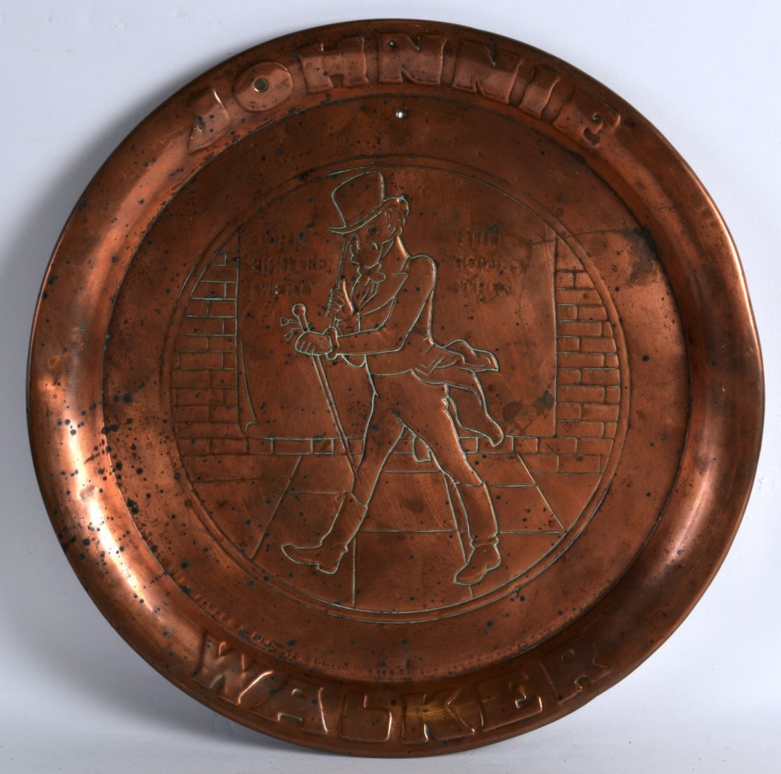 A VINTAGE JOHNNIE WALKER COPPER ADVERTISING TRAY
