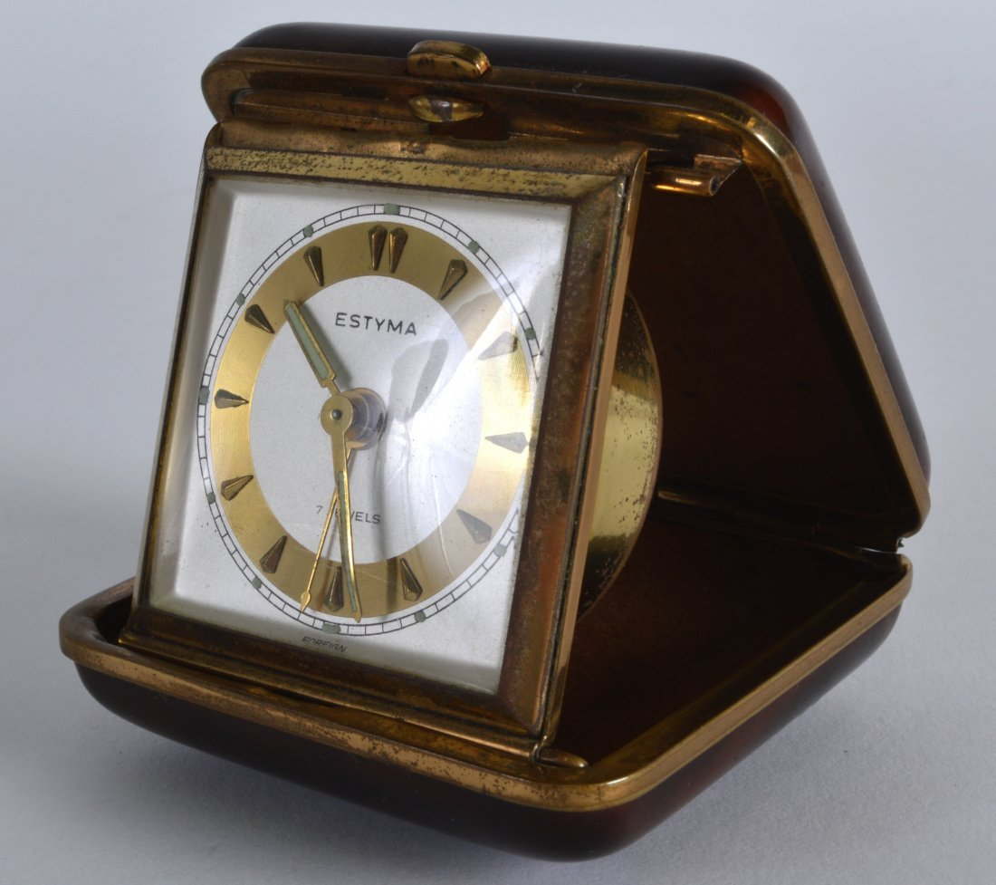 A 1940S CARVED TORTOISESHELL CASED TRAVELLING CLOCK