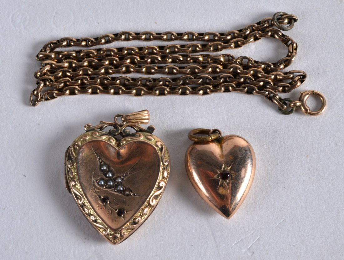 TWO 9CT GOLD LOCKETS with chains. (2)