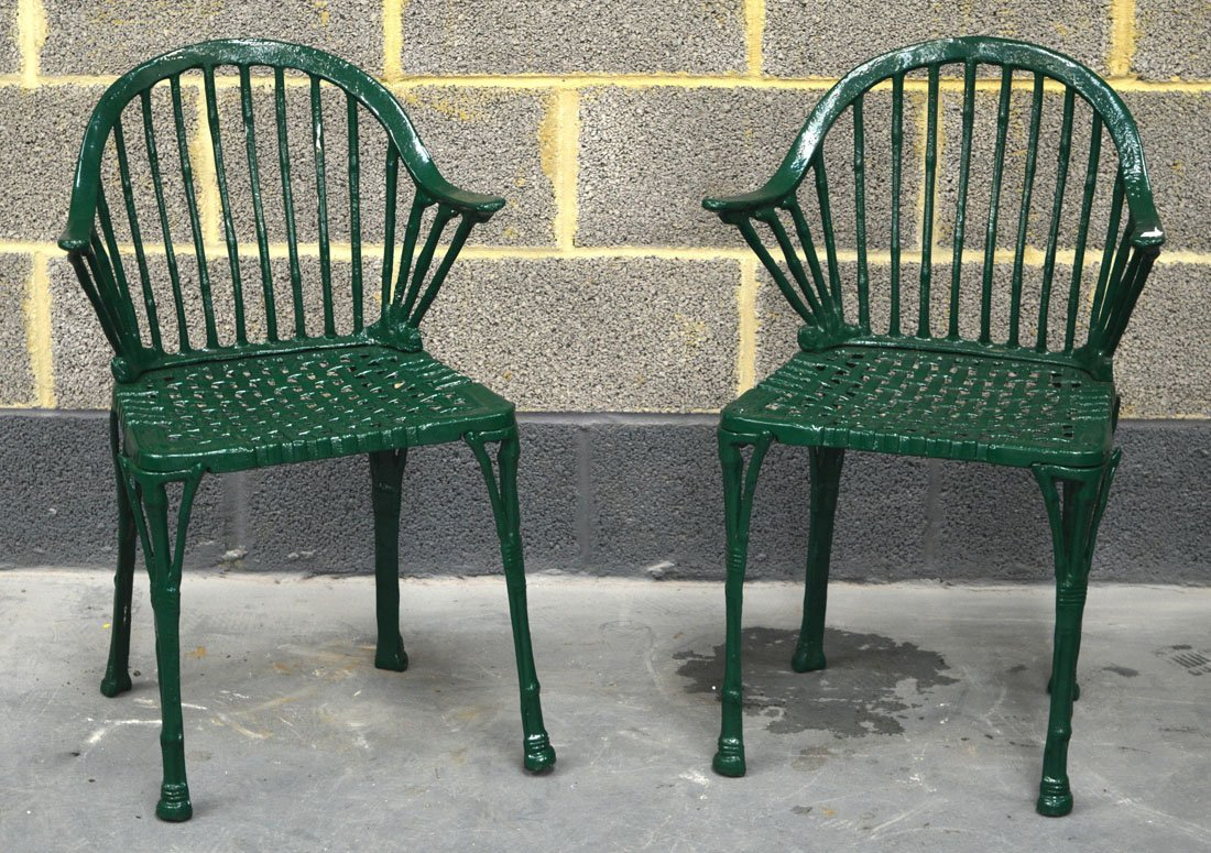 A PAIR OF VINTAGE GREEN PAINTED CAST IRON GARDEN