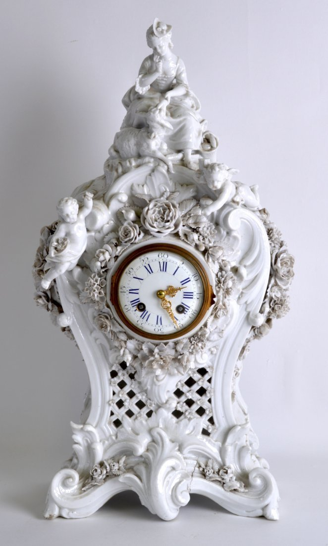 A LOVELY 19TH CENTURY GERMAN WHITE GLAZED MANTEL CLOCK